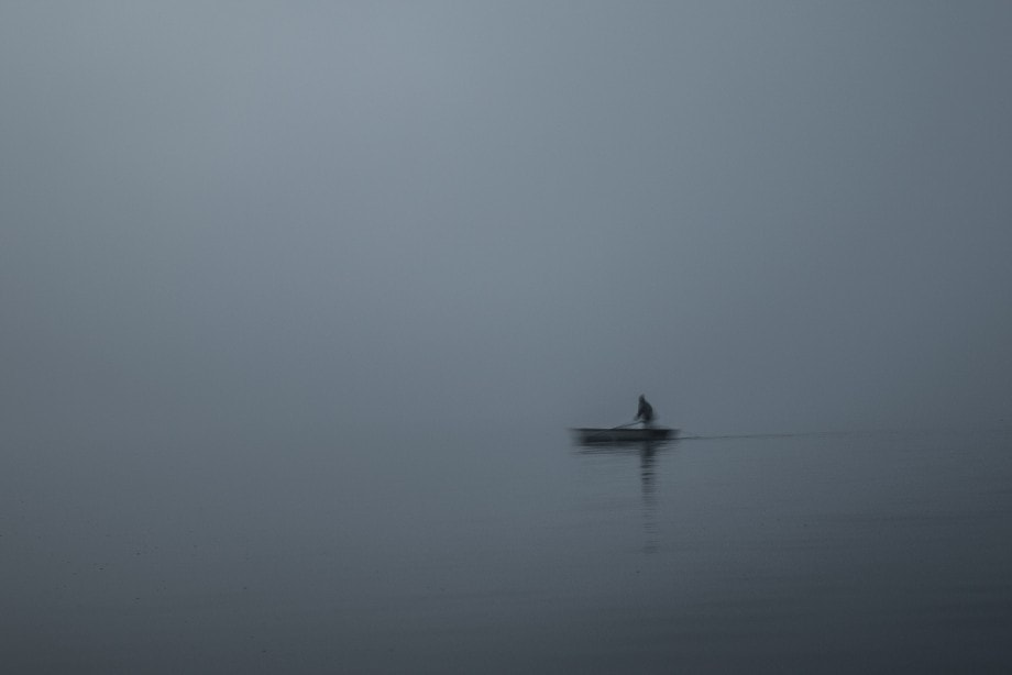 minimalist abstract of a lake and person rowing a boat by ken jennings