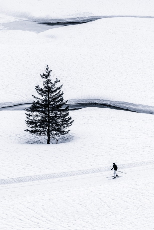 man on skiis traversing snow covered lands