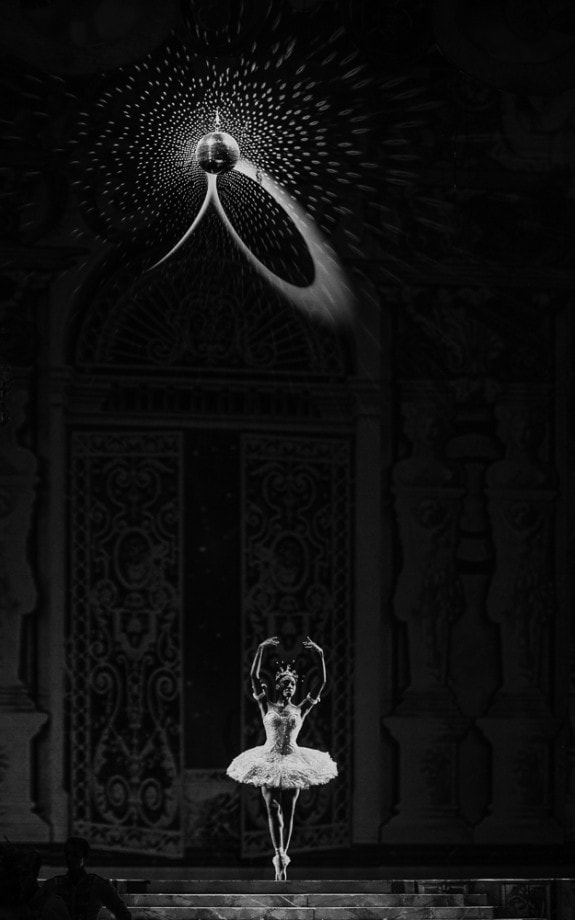 black and white photo of a ballerina performing on stage