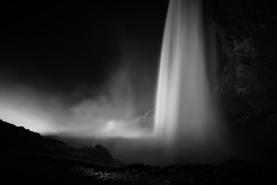 black and white fine art photo of the seljalandsfoss waterfall in iceland