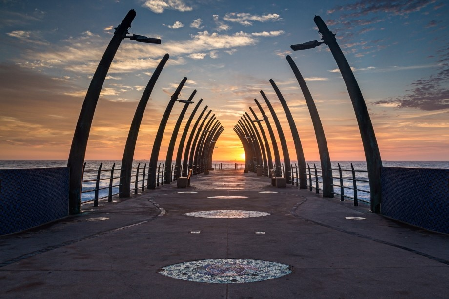 sunrise photo of a pier at the sea
