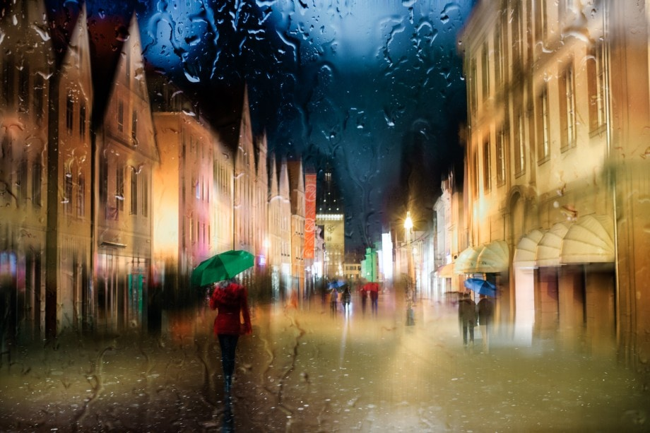 colourful composite of a street scene taken through a window on a rainy day.